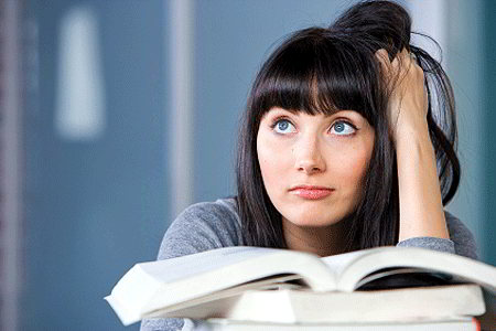Student distracted from studying (iStockphoto)