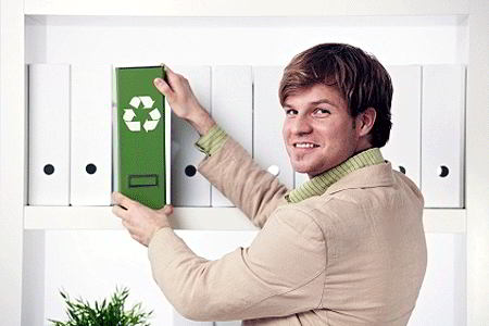 Businessman with green recycle folder