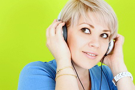 Woman listening to headphones (iStockphoto)