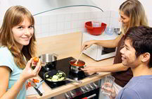 Friends cooking dinner together (iStockphoto)
