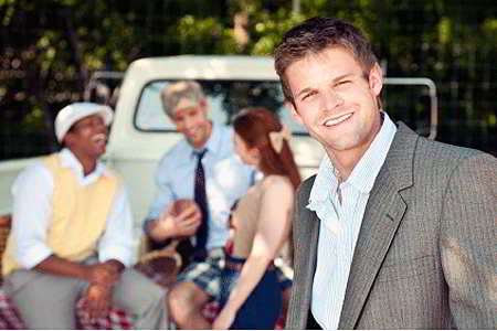 Young adults at tailgate party (iStockphoto)