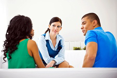 Couple with counselor (iStockphoto)