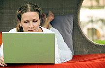 Female student on computer (iStockphoto)