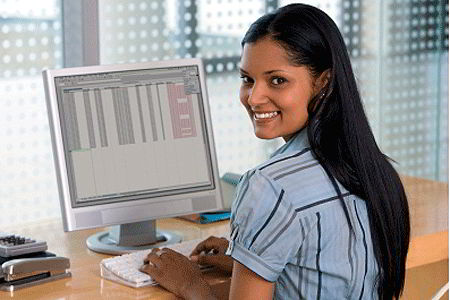 Young woman at computer (iStockphoto)