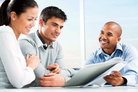 Financial advisor and clients (iStockphoto)